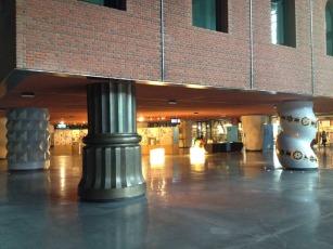 Pillars support three buildings inside
